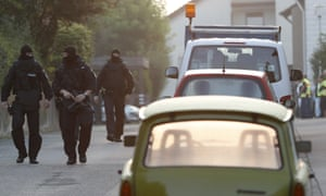 Armed police secure a street near the house where the bomber lived in Ansbach.