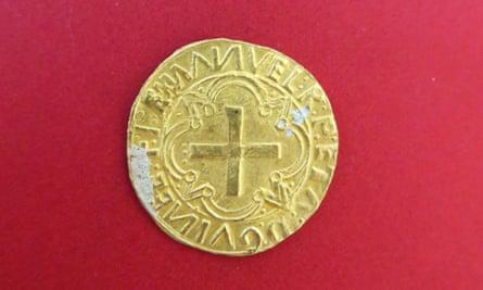 A Portuguese gold cruzado coin found at the wreck site.