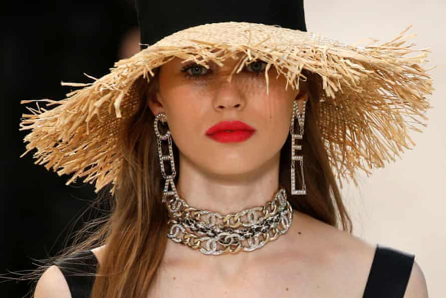 A straw hat with 80s-style jewellery.