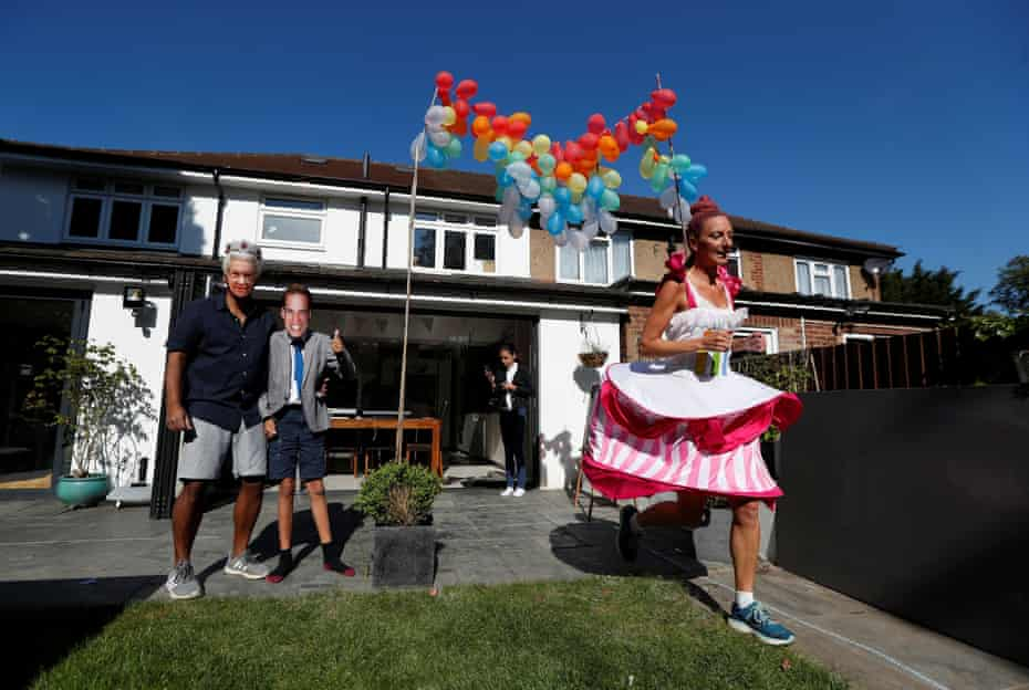 Anna Bassil runs a marathon distance on 26 April 2020 dressed as a cake around her garden in St Albans, after the London Marathon had to be postponed.