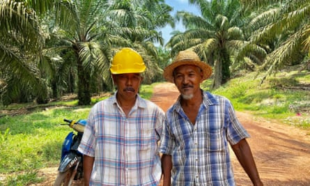 Malaysian palm oil farmers Nur Harun Muhammad and Nodin Bin Ramli.