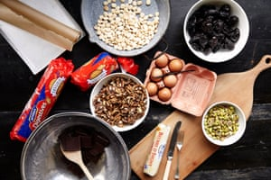 Ingredients for chocolate fridge cake: eggs, nuts, prunes, chocolate and so on.