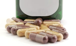 Herbal pills with a medicine bottle