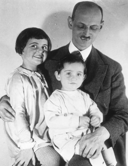 Anne Frank with her father and sister in 1931.