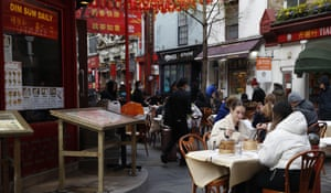 Customers eat outside a Chinese restaurant in the Soho area of London