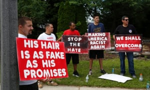 Anti-Trump protestors gather outside a rally for US Republican presidential candidate Donald Trump at the Summit Sports and Ice Complex on August 19, 2016 in Diamondale, Michigan.