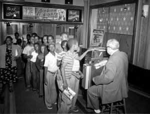 Children entering a movie theater, c. 1950