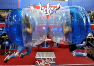 Sales people demonstrate the Soccer Bopper Body Bubble ball by Wicked