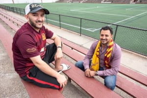 Salah Hadwan, front, and Moortadha Obaid, pose for a photo at the stadium of Detroit FC.