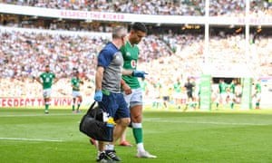 Conor Murray leaves the pitch with an injury during the first half of Ireland's heavy defeat to England.