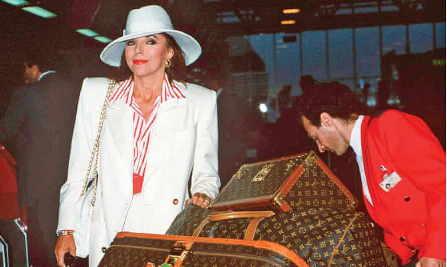 Joan Collins wonders if she can get this lot in with her hand luggage.