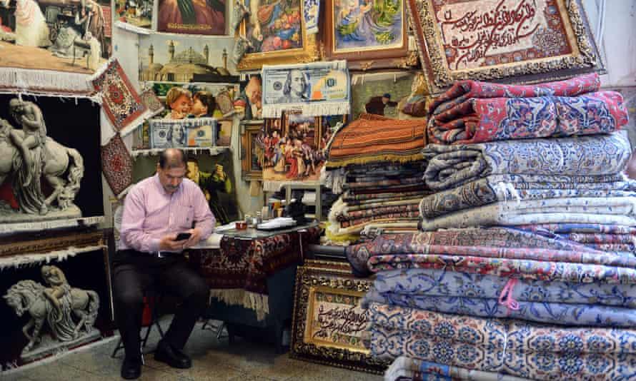 A carpet seller at a bazaar in Tehran