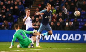 Harry Kane dinks the ball over Davies for the seventh.