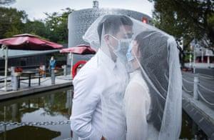 Shenzhen, China: Zhang Lingwen and Huang Miaowei pose for photos after their wedding