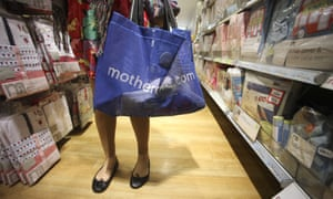 A customer holds a bag at a Mothercare shop in London.