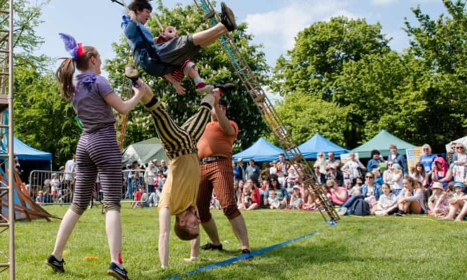 Circus skills performers outdoors at the So Festival, Lincolnshire, UK.