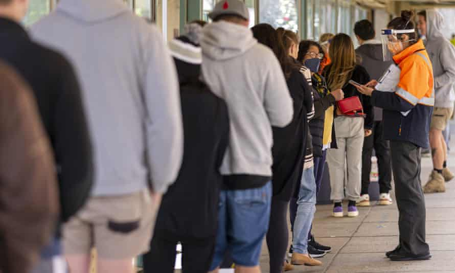 People queue outside a Covid vaccination hub in Melbourne