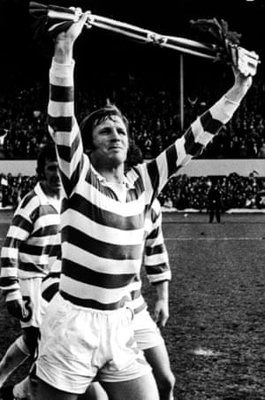 Celtic captain Billy McNeill leads the lap of honour, after his team's 3-1 Scottish Cup final victory over Airdrieonians.