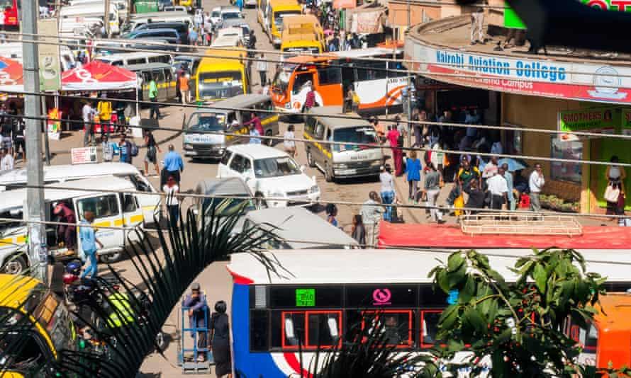 Buses and matatus along Latema Street, Downtown Nairobi, Kenya.