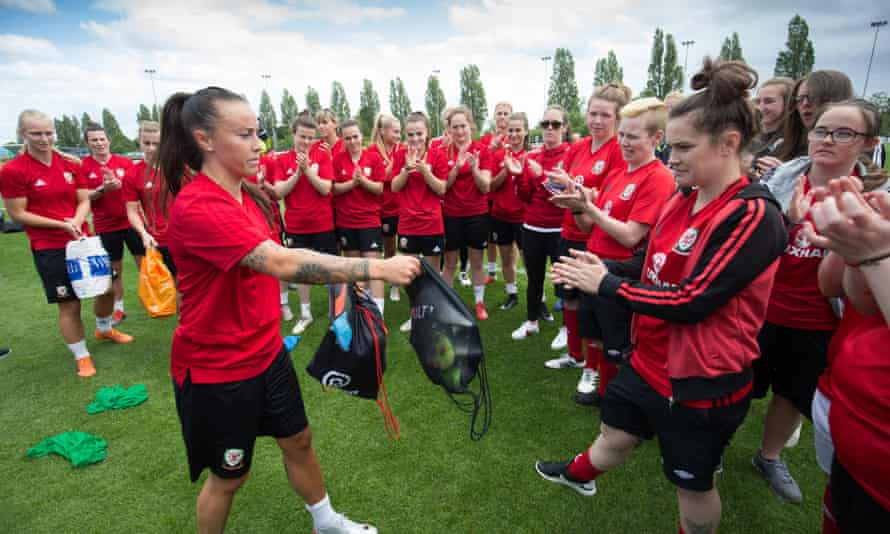 The Wales Homeless World Cup team are presented with spare kits and boots by Wales's women's football squad.