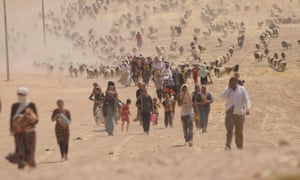 Displaced Yazidis from Sinjar fleeing Isis walk towards the Syrian border, August 2014