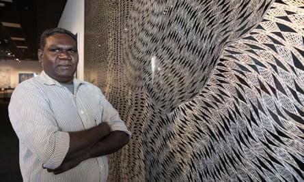 Gunybi Ganambarr, the overall winner of the 2018 Telstra National Aboriginal and Torres Strait Islander Art awards, with his winning work, Buyku.