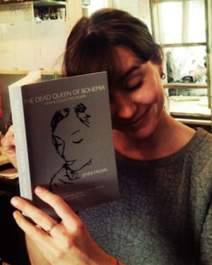Woman holding a copy of Dead Queen of Bohemia, Jenni Fagan's surrealistic poems about a life on the edge