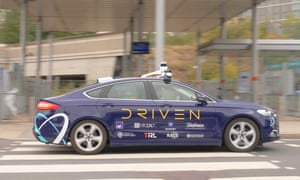A Driven autonomous vehicle driving through Stratford, east London.