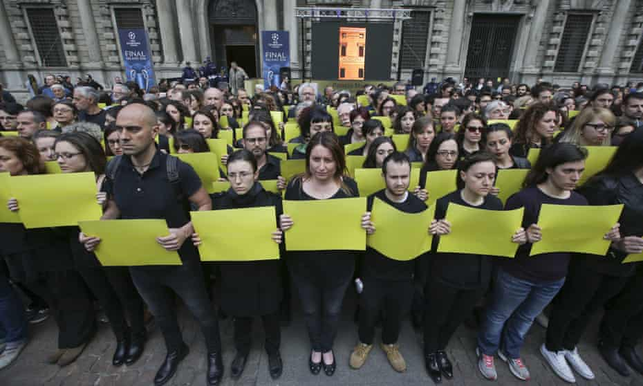 Amnesty International activists stage a flash mob asking for truth on the death of Italian student Guido Regeni, in front of Milan's city hall, Italy, Sunday, April 24, 2016.