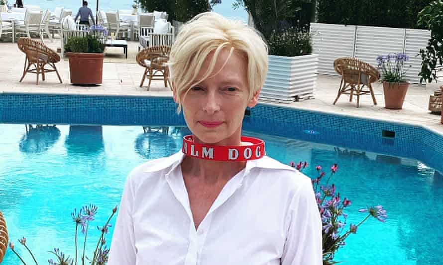Tilda Swinton wearing the Palm Dog collar after her dogs won the prize for best canine performance in a film showing at Cannes