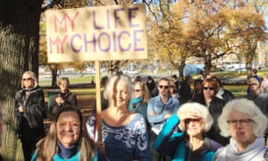 Hobart woman Jennie Brice holds a placard outside Tasmania's parliament ahead of the vote on the Voluntary Assisted Dying bill.