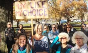 Hobart woman Jennie Brice holds a placard reading, 'My life, my choice'.