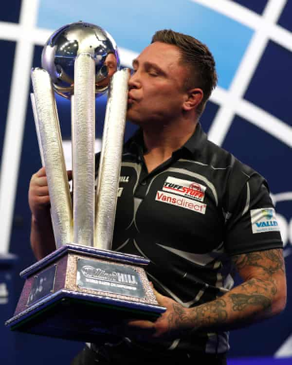 Gerwyn Price kisses the PDC world championship trophy