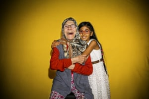 Ankara, TurkeyAn older woman and a young girl smile for World Smile Day celebrations at a nursing home