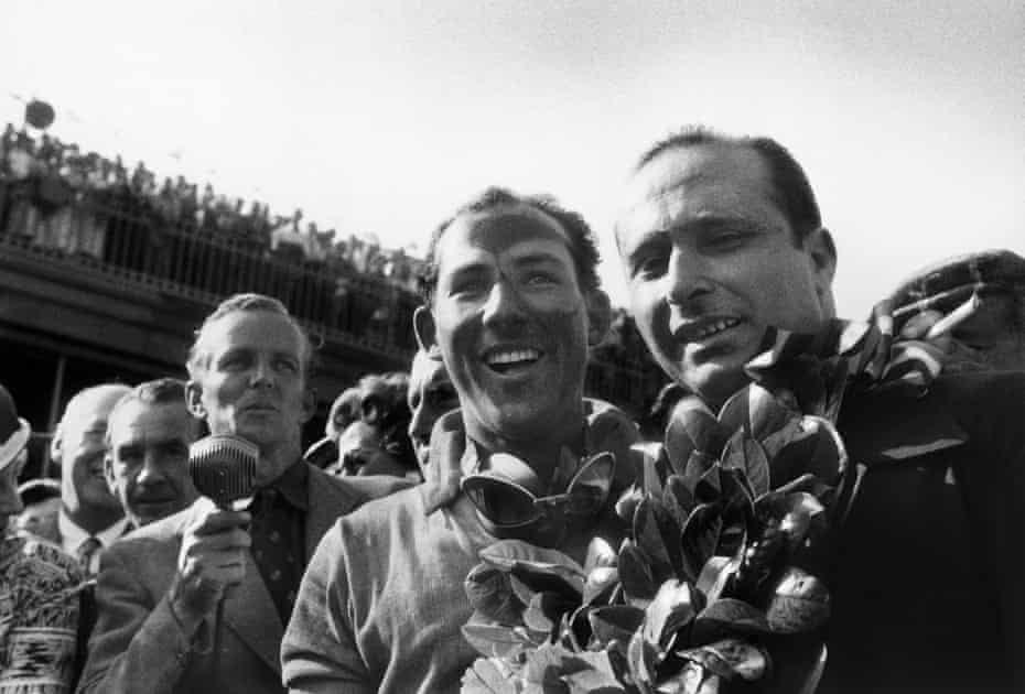 Stirling Moss and Juan Manuel Fangio on the podium at the British Grand Prix at Aintree in 1955.