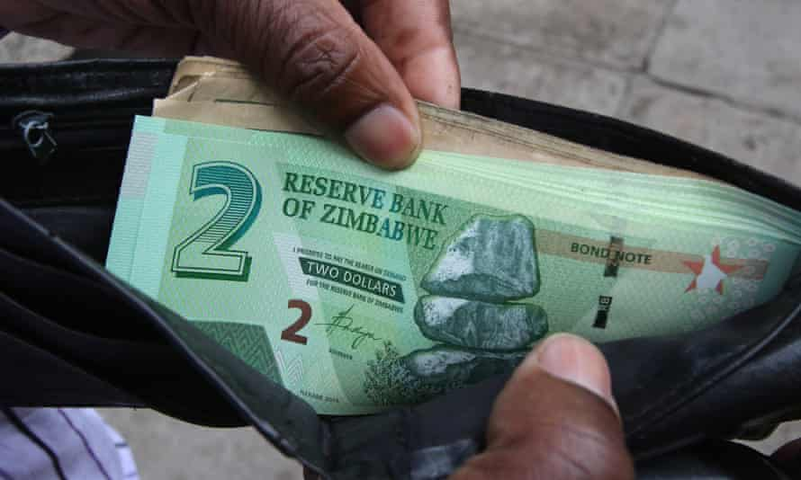 A Zimbabwean man shows off new bond notes in Harare.
