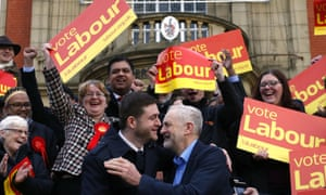 Labour party leader Jeremy Corbyn embraces the newly elected member of parliament for Oldham West and Royton, Jim McMahon, outside Chadderton Town Hall