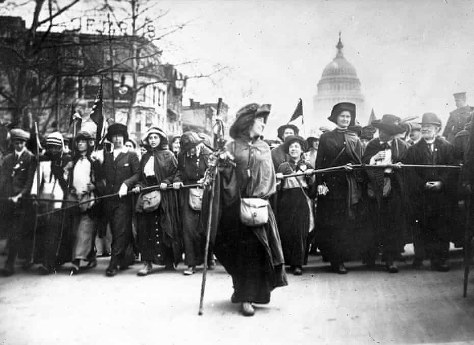 American suffragette Rosalie Jones leads a crowd of protesters up Pennsylvania Avenue after a march from New York in 1913.