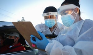 Healthcare workers in El Paso, Texas. More than 11 million Americans have been infected during the pandemic, by far the largest total in the world.
