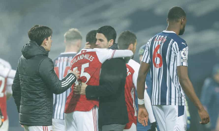 Mikel Arteta hugs Ainsley Maitland-Niles after Arsenal's 4-0 win at the Hawthorns in January