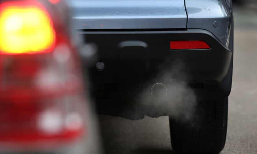 Exhaust fumes from a car in Putney High Street, London