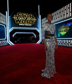 Lupita Nyong'o (Pirate Queen Maz Kanata) has a mermaid shine in her silver sequin dress with cut-outs.