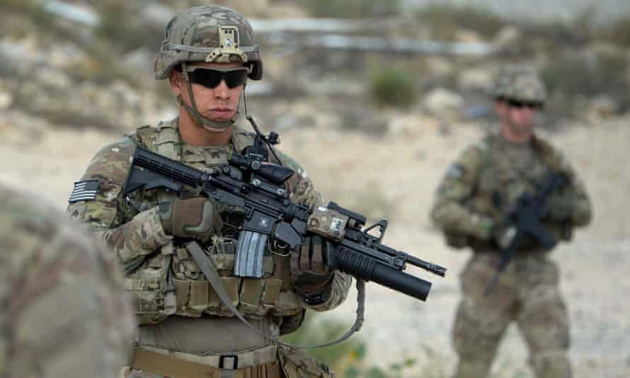 US soldiers patrol in Afghanistan. President Barack Obama announced last year that thousands of US troops will remain in the country past 2016, retreating from a major campaign pledge.