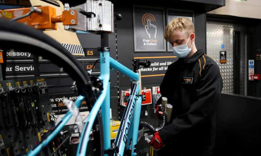 A member of staff works on a bike at Halfords in Rugby