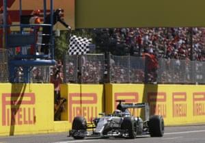Lewis Hamilton crosses the finish line to win.