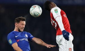 Chelsea's Danny Drinkwater beats Danny Welbeck of Arsenal in the air.