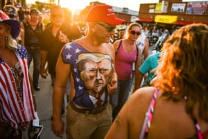 Johne Riley shows off his chest painted with a portrait of Donald Trump during the 80th annual Sturgis motorcycle rally on 7 August 2020 in Sturgis, South Dakota, which usually attracts around 500,000 people.