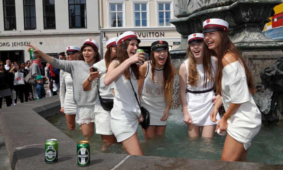 Students celebrate the end of high school in Copenhagen.