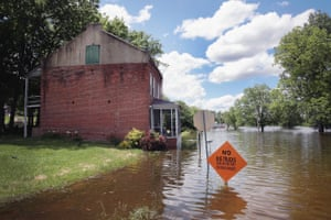 Floodwater from the Mississippi River overtakes a street on 30 May 2019 in Saint Mary, Missouri