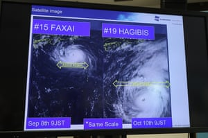 A television screen at World Rugby's press conference shows the potential impact of Typhoon Hagibis